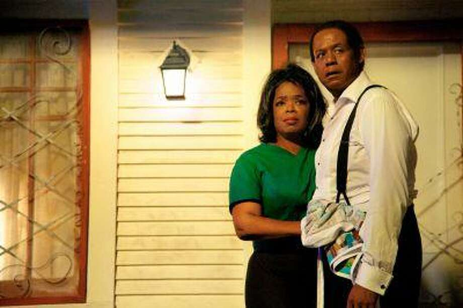 """This film image released by The Weinstein Company shows Oprah Winfrey as Gloria Gaines, left, and Forest Whitaker as Cecil Gaines in a scene from """"Lee Daniels' The Butler."""" Photo: AP / The Weinstein Compnay"""
