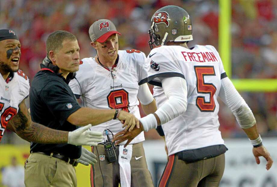 Tampa Bay quarterback Josh Freeman has been released by the Buccaneers one week after being benched in favor of rookie Mike Glennon. Photo: Phelan M. Ebenhack — The Associated Press   / FR121174 AP