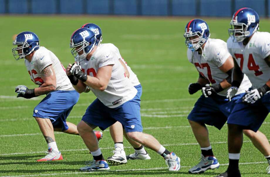 New York Giants offensive lineman David Diehl, left, works out with during practice on Sept. 25 in East Rutherford, N.J. Photo: Julio Cortez — The Associated Press   / AP