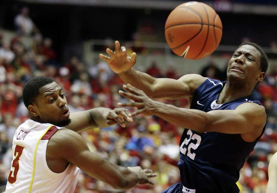 Iowa State forward Melvin Ejim, left, fights for a rebound with Yale forward Justin Sears during the second half of an NCAA college basketball game, Tuesday, Jan. 1, 2013, in Ames, Iowa. Iowa State won 80-70.(AP Photo/Charlie Neibergall) Photo: AP / AP