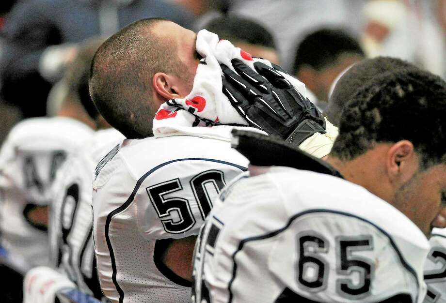 UConn's Tyler Bullock sits on the bench late in the fourth quarter of the Huskies' 40-10 loss to Syracuse on Oct. 19, 2012, in Syracuse, N.Y. Photo: Kevin Rivoli — The Associated Press   / FR60349 AP