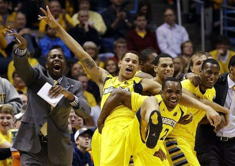 Marquette's bench reacts against Connecticut during the second half of an NCAA college basketball game, Tuesday, Jan. 1, 2013, in Milwaukee. (AP Photo/Jeffrey Phelps) Photo: AP / FR59249 AP