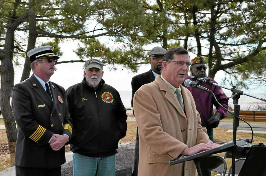 Mayor Edward M. O'Brien delivers remarks during the city's annual observance of National Pearl Harbor Remembrance Day Dec. 7 at the William A. Soderman Memorial Flagpole in Bradley Point Park. Looking on, from left, are West Haven Fire Department Chief James P. O'Brien, the event's master of ceremonies, along with Veterans Council Vice President Dave Ricci, Planning and Zoning Commission Vice Chairman Steven R. Mullins and Veterans of Foreign Wars Post 9422 Cmdr. Fred Jackson. Contributed photo Photo: Journal Register Co.