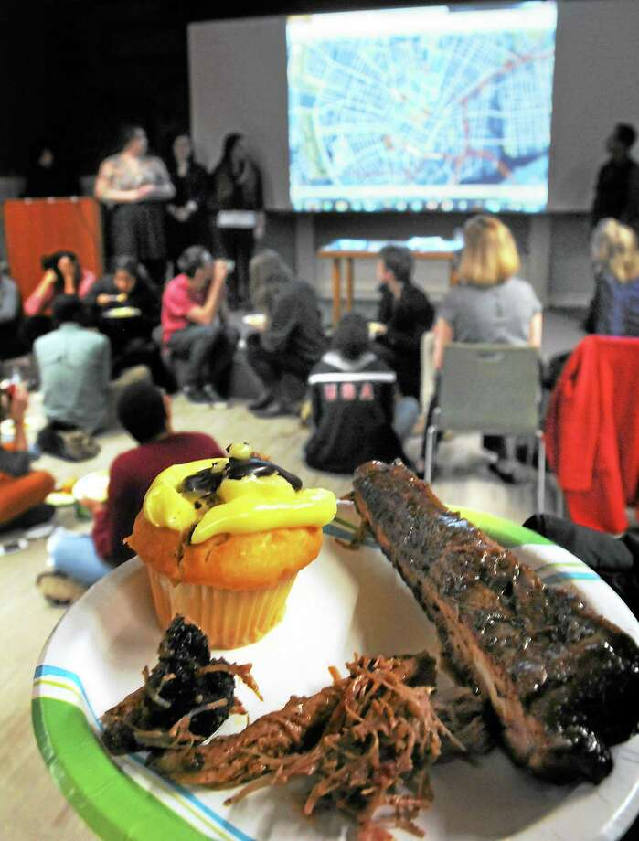 Yale students launched a website devoted to New Haven food trucks, and offered some of the trucks' food at an event at New Haven Free Public Library recently. Photo: Mara Lavitt — New Haven Register       / Mara Lavitt