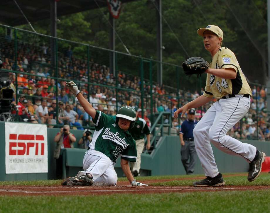Westport'e Charlie Roof slides safely into home plate in the top of the second inning against Eastlake on Sunday in the Little League World Series. (Mary Albl -- Register)