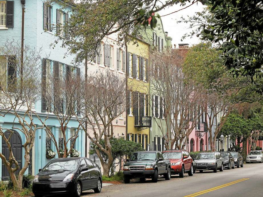 One of the most iconic vistas in Charleston, S.C., Rainbow Row, is seen in this March 11, 2013 photograph. It's free to walk through the city's historic district to see these and other historic homes. (AP Photo/Bruce Smith) Photo: AP / AP