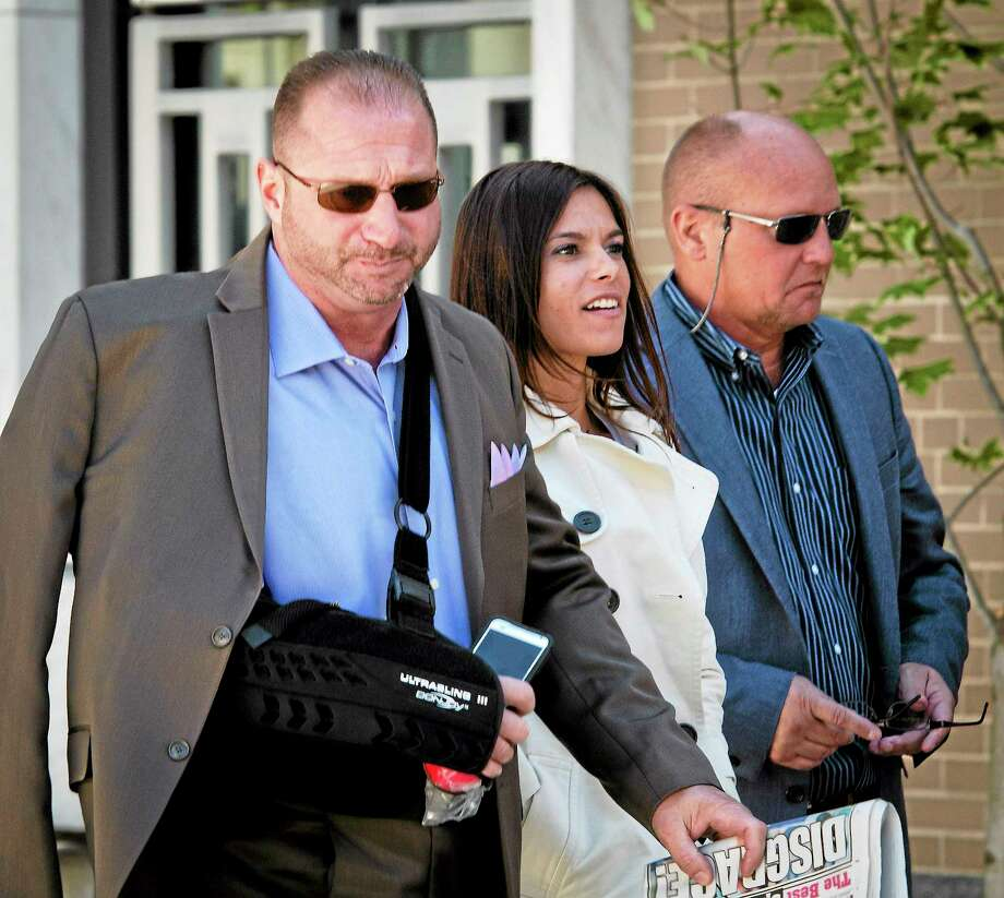 East Haven Police Officer Robert Ranfone, left, leaves U.S. District Court in Hartford in late September during the trial of fellow Officers Dennis Spaulding and David Cari. Photo: Melanie Stengel — New Haven Register