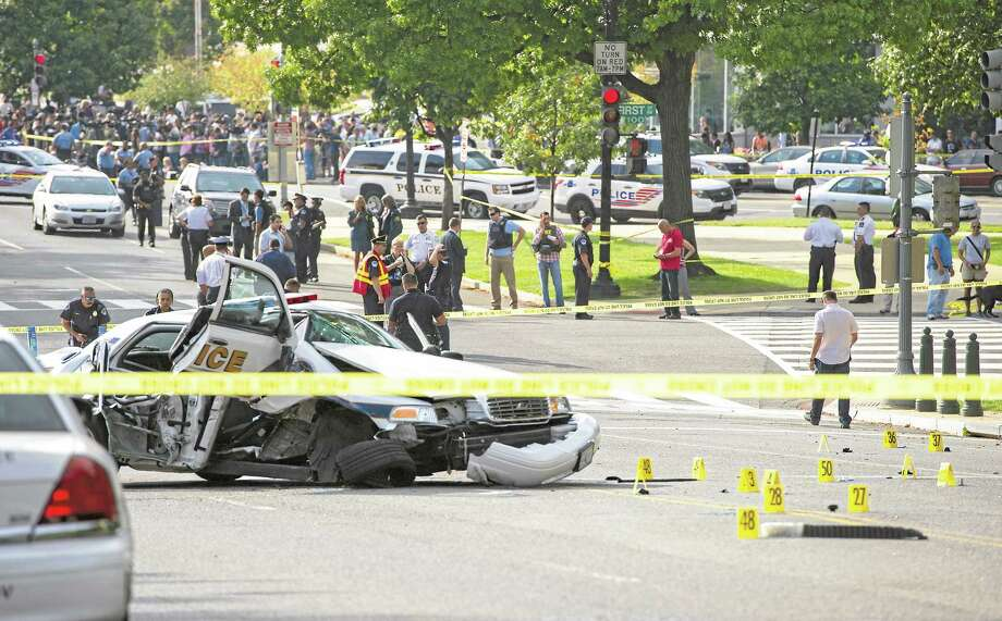 "A police cruiser is wrecked after shots fired were reported near 2nd Street NW and Constitution Avenue on Capitol Hill in Washington, DC, on October 3, 2013. The US Capitol was placed on security lockdown Thursday after shots were fired outside the complex, senators said. ""Shots fired outside the Capitol. We are in temporary lock down,"" Senator Claire McCaskill said on Twitter. Police were seen running within the Capitol building and outside as vehicles swarmed to the scene.    AFP Photo/Jim Watson        (Photo credit should read JIM WATSON/AFP/Getty Images) Photo: AFP/Getty Images / 2013 AFP"