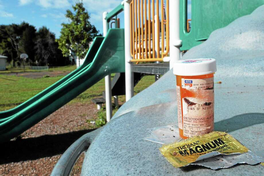 (Mara Lavitt — New Haven Register)   September 30, 2013 East Haven.  Michael Street Park resident Robert Hoff points out how the park has deteriorated from city neglect and become a location for drugging and drinking, since it was renovated in 2009. An empty oxycodone bottle, condom wrapper, and small drug bags were found under this playscape. Photo: Journal Register Co. / Mara Lavitt