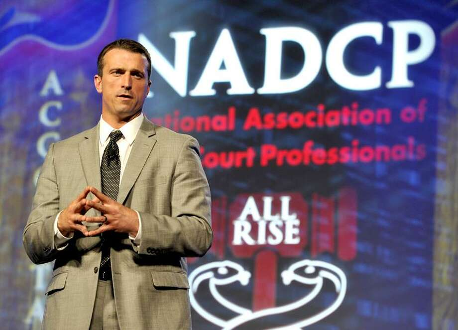 COMMERCIAL IMAGE - In this photograph taken by AP Images for The National Association of Drug Court Professionals, Chris Herren discusses his journey from the NBA to a life of recovery at the NADCP 18th Annual Training Conference, on Saturday, June 2, 2012 in Nashville, Tenn. (Frederick Breedon / AP Images for The National Association of Drug Court Professionals) Photo: AP IMAGES FOR THE NATIONAL ASSOC / AP2012