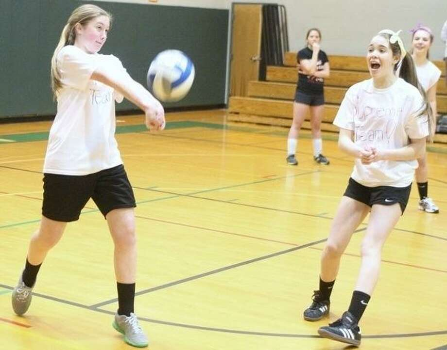 Dispatch Photo by John Haeger @OneidaPhoto on Twitter Supreme Team's Sara Russin bumps the ball as teammate Caitlin Purdy cheers her on during a volleyball game to benefit  the East Rockaway School District on Saturday, March 2, 2013 in Hamilton. The East Rockaway District had many of its facilities damaged by hurricane Sandy .