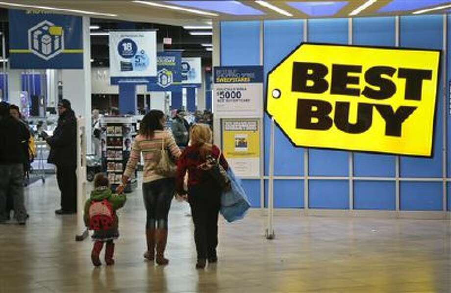 Shoppers enter a Best Buy in New York. Brick-and-mortar retailers like Wal-Mart and Best Buy for years have been contending with Amazon's ruthlessly low prices online. But this holiday season, they're fighting back harder than ever, matching online prices, opening up on Thanksgiving Day earlier and ramping up shipping options. Photo: AP / AP