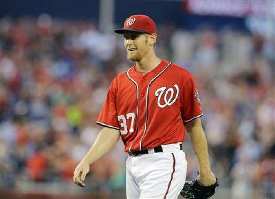 Washington Nationals pitcher Stephen Strasburg, smiles after the last out in a win over the Philadelphia Phillies at Nationals Park Sunday, Aug. 11, 2013, in Washington. Strasburg pitched his first complete game, and the Nationals won 6-0. Photo: AP / AP