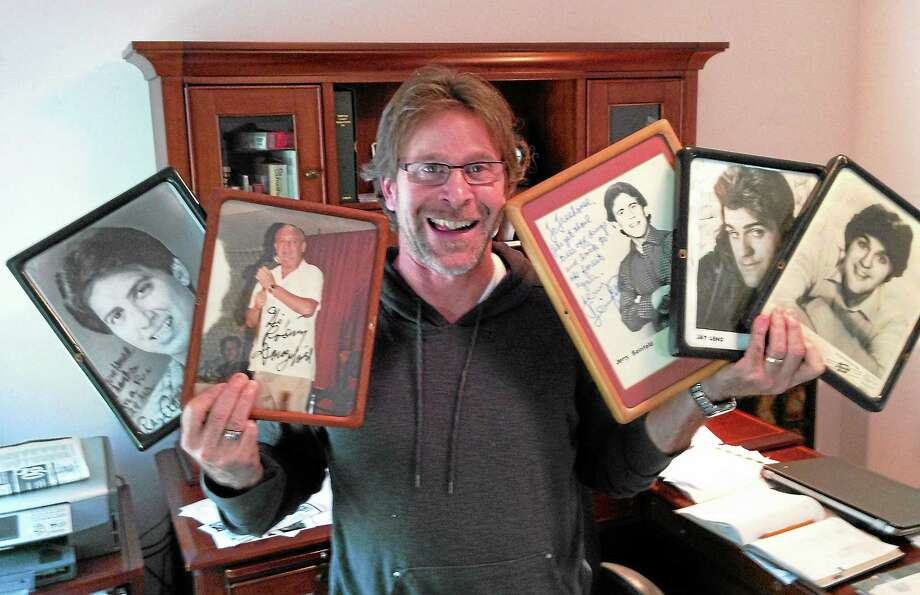 Brad Axelrod with autographed pictures of Ray Romano, Rodney Dangerfield, Jerry Seinfeld and Jay Leno. Photo: Joe Amarante — Register