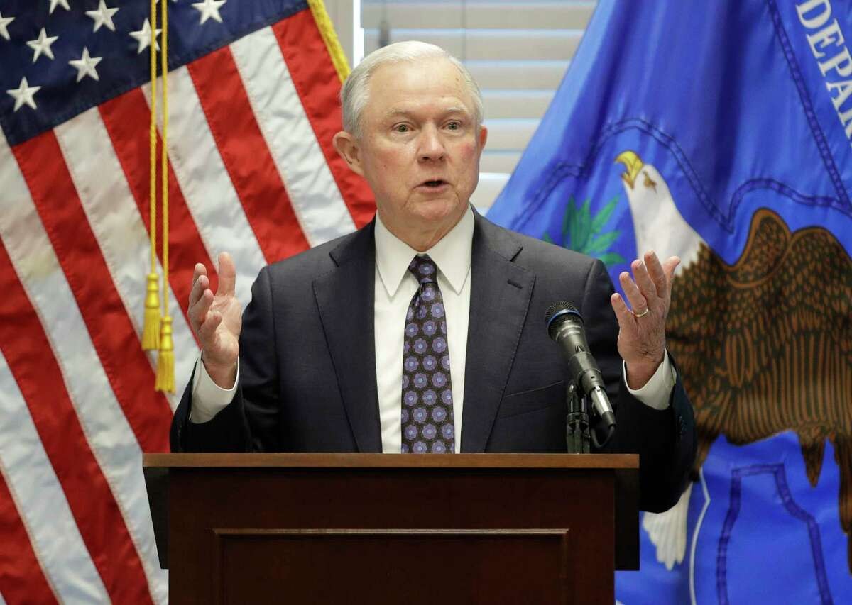 FILE - In this July 12, 2017, file photo, Attorney General Jeff Sessions speaks to federal, state and local law enforcement officials about sanctuary cities and efforts to combat violent crime, in Las Vegas. The Justice Department escalated its promised crackdown on so-called sanctuary cities on July 25, saying it will no longer give cities coveted grant money unless they give federal immigration authorities access to jails and provide advance notice when someone in the country illegally is about to be released. (AP Photo/John Locher, File)