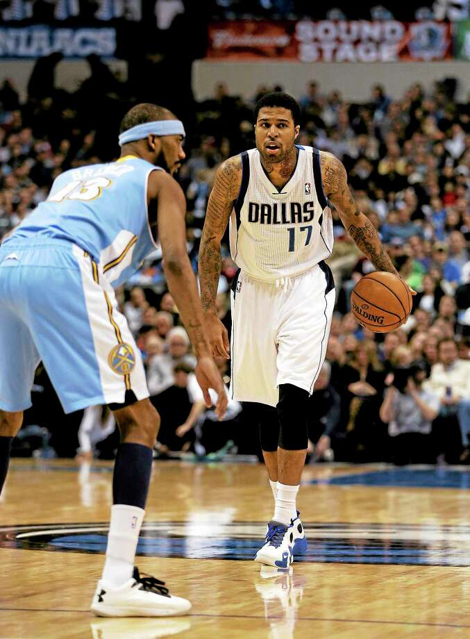 The Denver Nuggets' Corey Brewer defends as the Mavericks' Chris Douglas-Roberts brings the ball up court during a game on Dec. 28, 2012, in Dallas. Photo: Tony Gutierrez — The Associated Press   / AP2012