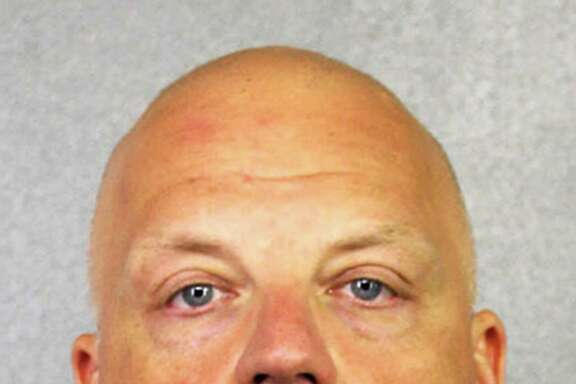 FILE - This January 2017 file photo provided by the Broward County Sheriff's Office shows German Volkswagen executive Oliver Schmidt. A court spokesman in Detroit said Tuesday, July 25, 2017, that Schmidt plans to plead guilty in the company's U.S. emissions scandal. Schmidt will appear in federal court on Aug. 4. He's been in custody since January when he was arrested while on vacation in Miami. (Broward County Sheriff's Office via AP, File)
