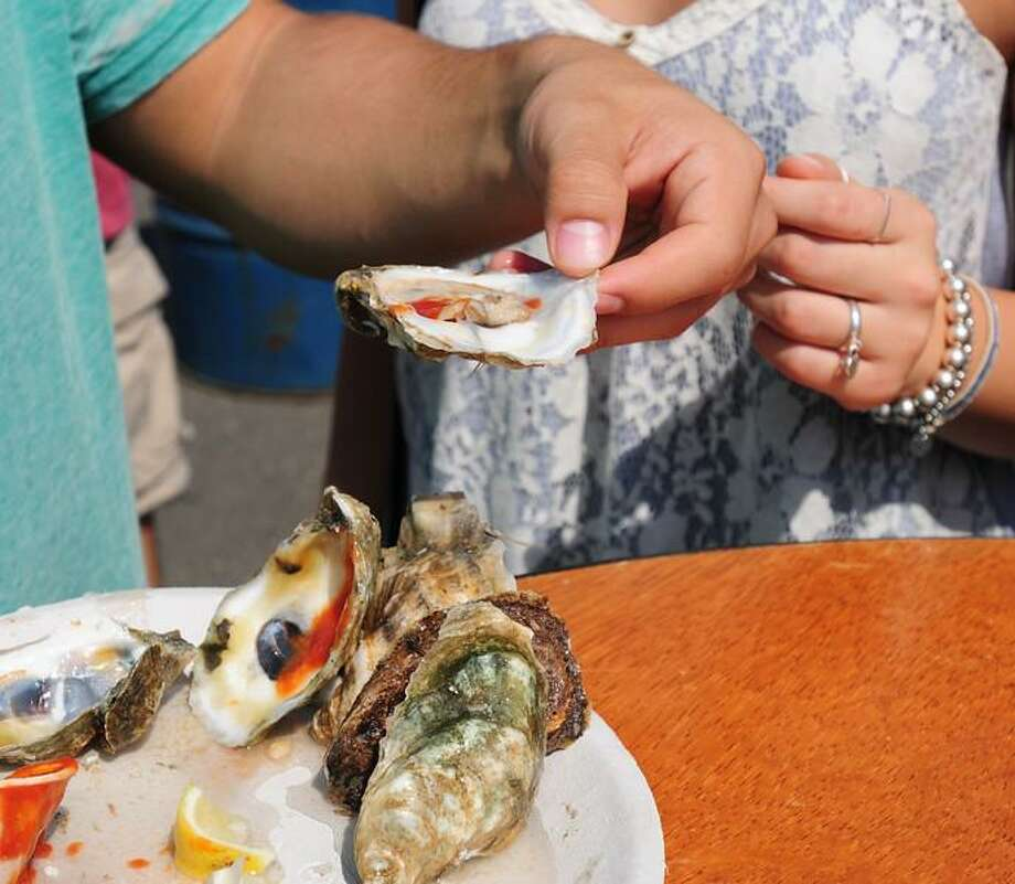 The Milford Oyster Festival in Milford, Connecticut Saturday August 17, 2013. Photograph by Peter Hvizdak