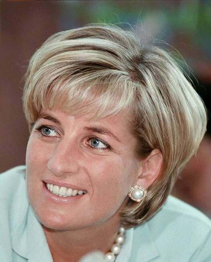 Diana, the Princess of Wales during her visit to Leicester in this May 27, 1997 file photo, to formally open The Richard Attenborough Centre for Disability and Arts. The Princess was killed in a car crash in Paris Sunday August 31, 1997, along with her friend, Dodi Al Fayed, and their driver. (AP Photo/POOL) Photo: ASSOCIATED PRESS / AP1997