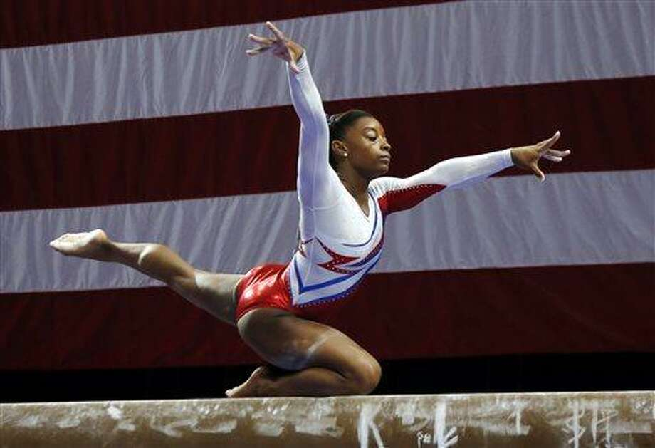 Simone Biles competes on the balance beam during the U.S. women's national gymnastics championships in Hartford, Conn., Saturday, Aug. 17, 2013. (AP Photo/Elise Amendola) Photo: AP / AP