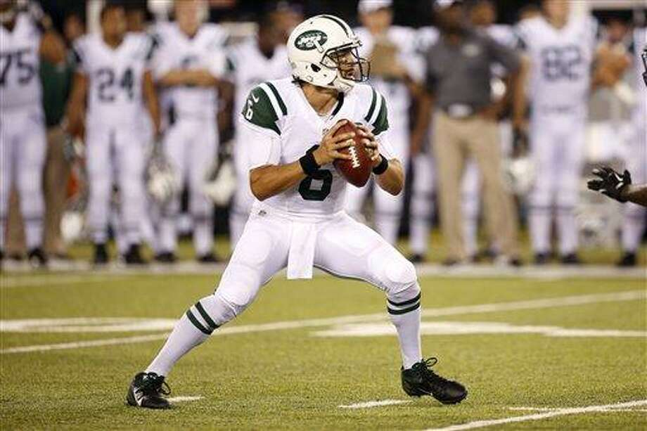 New York Jets quarterback Mark Sanchez looks to pass against the Jacksonville Jaguarsduring the first half of an NFL preseason football game, Saturday, Aug. 17, 2013, in East Rutherford, N.J. (AP Photo/John Minchillo) Photo: AP / FR170537 AP
