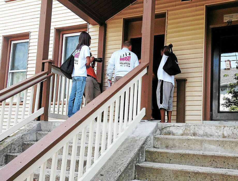 Superintendent Garth Harris at the first stop of Kindergarten Canvass for Augusta Lewis Troup School. Photo: Journal Register Co.