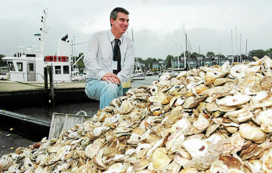 Photos by Peter Hvizdak — RegisterDavid H. Carey, Director of the State of Connecticut Department of Agriculture and its Bureau of Aquaculture and Laboratory in Milford, Conn. with shellfish that were tested in the lab there. Photo: New Haven Register / ©Peter Hvizdak /  New Haven Register