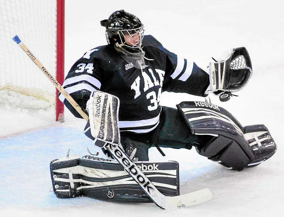 Yale freshman goalie Alex Lyon makes one of his 48 saves during the Bulldogs' 3-3 tie at Quinnipiac on Nov. 9. Photo: Arnold Gold — Register