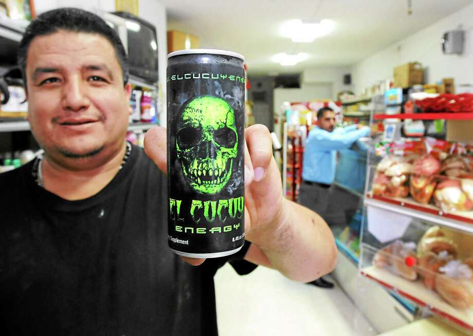 Mara Lavitt — Register August 14, 2013 New Haven. Rene Medel Saldana, owner of America Foods on Grand Ave., sells an energy drink called El Cucuy being marketed to Hispanics. Photo: Journal Register Co.
