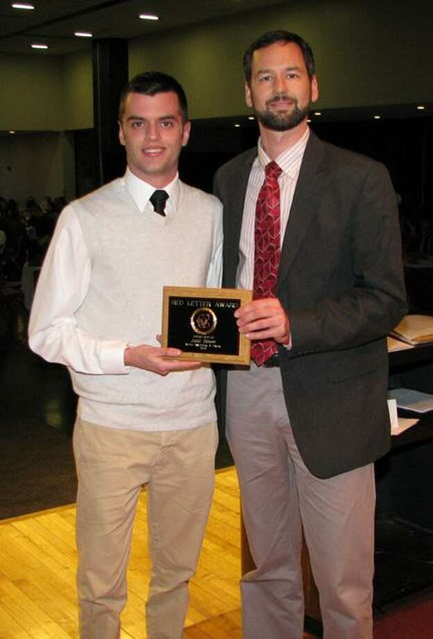 SUBMITTED PHOTO Cortland State's Judd Simon, left, poses with men's swimming and diving head coach Brian Tobin with the 2013 MVP Red Letter Award for Men's Swimming and Diving.