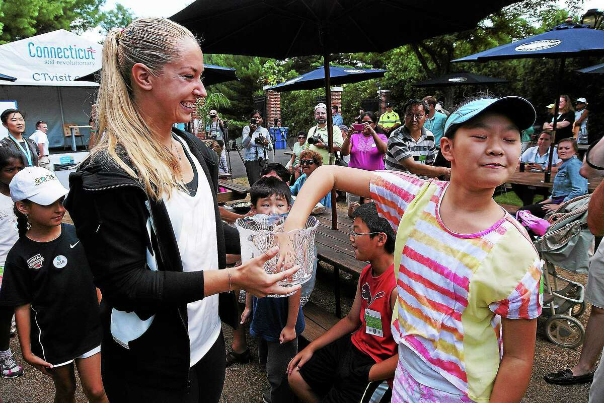 Peter Casolino — RegisterPro Sabine Lisicki gets a pick from Sophia Zhang,11, of Trumbull during the the Draw ceremony at the New Haven Open at Yale.pcasolino@newhavenregister.com