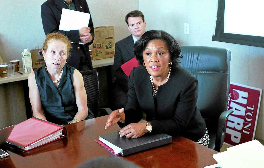 (Peter Casolino — New Haven Register) Mayoral candidate Toni Harp talks with the media during a presentation announcing her economic development plan for the city. On the left is; Barbara Pearce of Pearce Realty.  10/02/13 Photo: Journal Register Co.