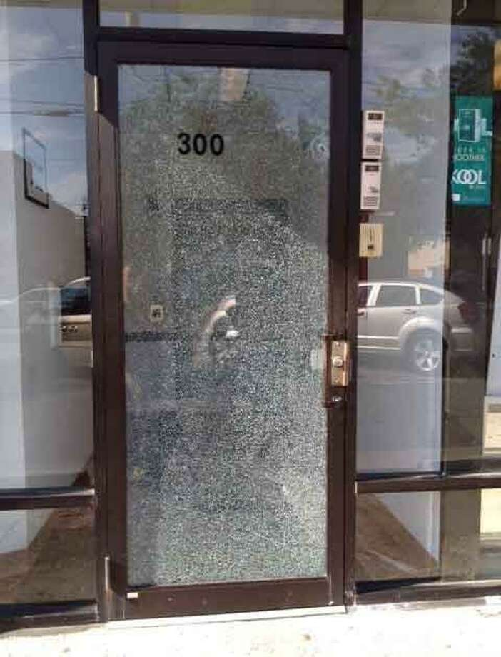 The campaign of New Haven mayoral candidate Toni Harp reported that the door to Renaissance Management -- the company run by her son and founded by her late husband -- was shot at. Matthew Harp, discovered the damaged door, seen above, Friday morning when he arrived at work. Mary O'Leary/Register