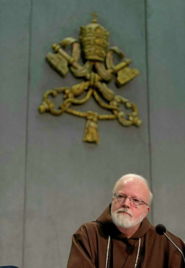 Cardinal Sean O'Malley, the archbishop of Boston, listens to a reporter's questions during a press conference at the Vatican, Thursday, Dec. 5, 2013. Pope Francis is assembling a panel of experts to advise him about protecting children from sexually abusive priests and about helping victims who have already been harmed. O'Malley announced the creation of the the commission  at the conclusion of a meeting between Francis and his eight cardinal advisers who are helping him govern the church and reform the Vatican bureaucracy. (AP Photo/Alessandra Tarantino) Photo: AP / AP