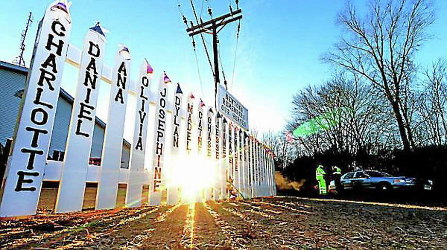 A memorial is seen near the entrance road to Sandy Hook Elementary School in Newtown Dec. 20, 2012. Photo: Tom Kelly IV   / © 2012 Tom Kelly IV