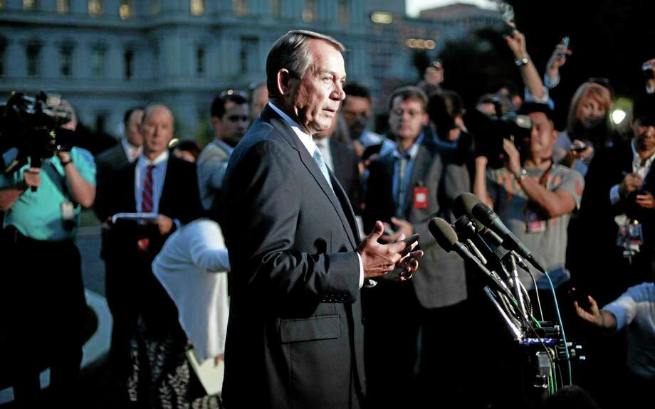House Speaker John Boehner, R-Ohio, speaks to members of the media after meeting with President Barack Obama at the White House in Washington, Wednesday, Oct. 2, 2013. Obama and congressional leaders met at the White House on the second day of a partial government shutdown (AP Photo/Pablo Martinez Monsivais) Photo: AP / AP