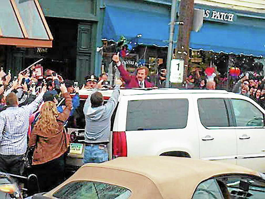 Will Ferrell, in character as Ron Burgundy, in downtown Milford Thursday. Photo: CONTRIBUTED PHOTO — The Dan Patrick Show