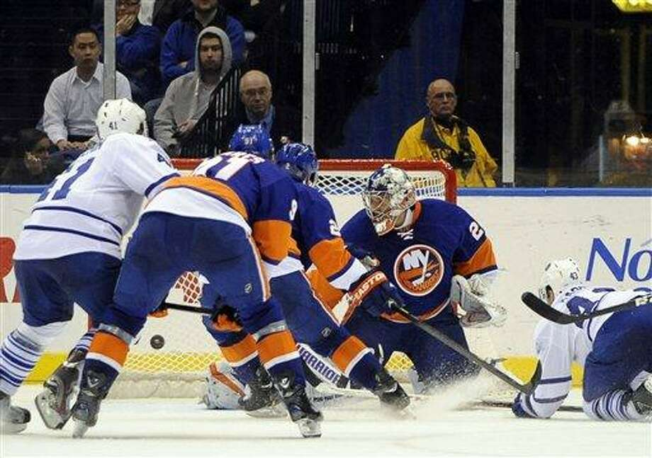 Toronto Maple Leafs' Nazem Kadri (43) shoots the puck past New York Islanders goalie Evgeni Nabokov (20) to a score a hat trick in the second period of an NHL hockey game, Thursday, Feb. 28, 2013, at Nassau Coliseum in Uniondale, N.Y. (AP Photo/Kathy Kmonicek) Photo: AP / FR170189 AP