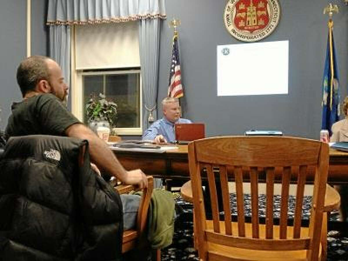 JASON SIEDZIK/ Register Citizen Town manager Dale Martin, right, hoped to receive directions from the Board of Selectmen before presenting his 2013-14 budget proposal.