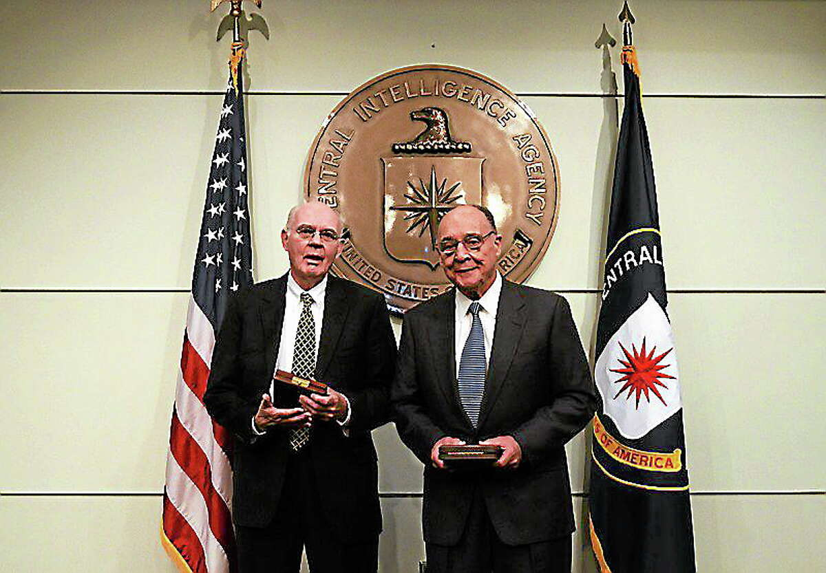 """Judge John """"Jack"""" Downey, left, and his fellow captive, Richard Fecteau received the highest honor for valor from the Central Intelligence Agency."""