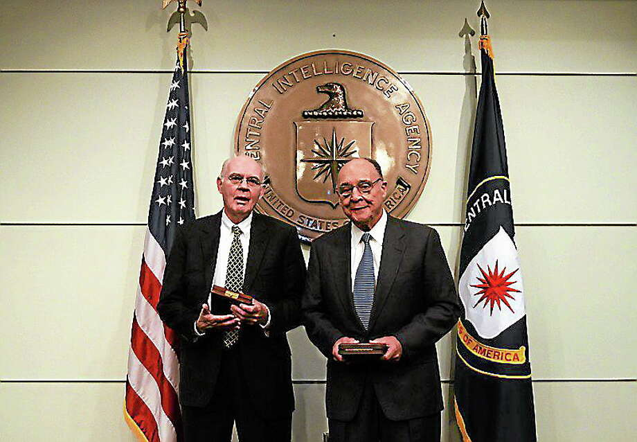 """Judge John """"Jack"""" Downey,  left, and his fellow captive, Richard Fecteau received the highest honor for valor from the Central Intelligence Agency. Photo: Journal Register Co."""