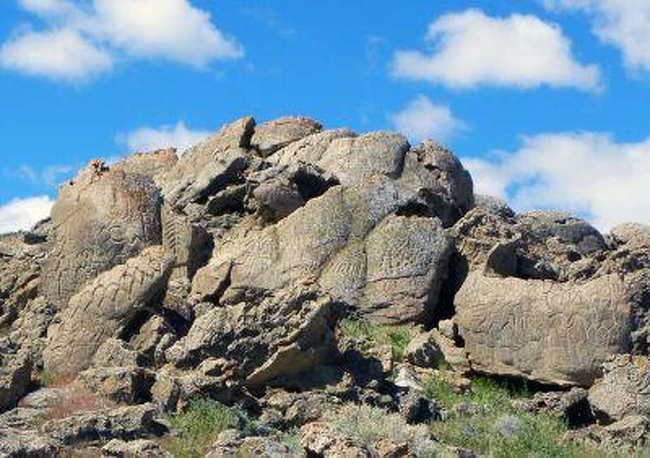 This May 2012 photo shows ancient carvings on limestone boulders near Nevada's Pyramid Lake which have been confirmed to be the oldest recorded petroglyphs in North America - at least 10,500 years old. Photo: ASSOCIATED PRESS / AP2011