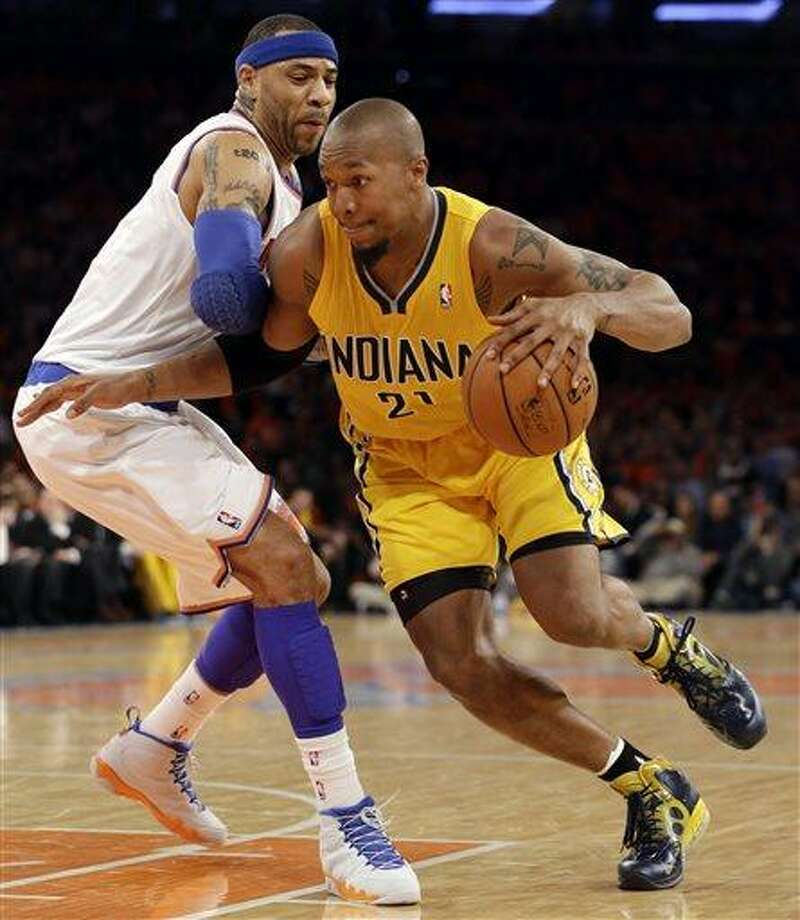 Indiana Pacers forward David West (21) drives past New York Knicks forward Kenyon Martin (3) in the second quarter of Game 1 of their second-round NBA basketball series at Madison Square Garden in New York, Sunday, May 5, 2013.  (AP Photo/Kathy Willens) Photo: AP / AP