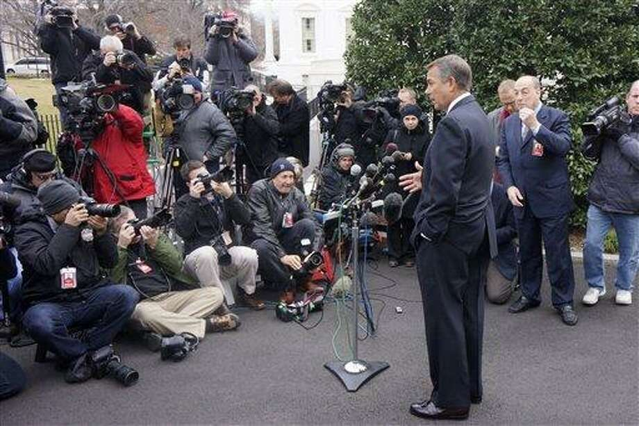 House Speaker John Boehner of Ohio talks to reporters outside the White House in Washington, Friday, March 1, 2013, following a meeting with President Barack Obama and Congressional leaders regarding the automatic spending cuts. (AP Photo/Charles Dharapak) Photo: AP / AP