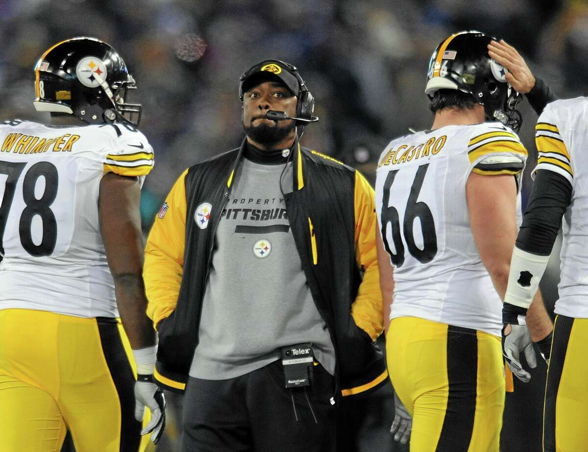 """Pittsburgh Steelers coach Mike Tomlin has been fined $100,000 for interfering with a play against the Baltimore Ravens on Thanksgiving. The NFL also said Wednesday that it would consider docking Pittsburgh a draft pick """"because the conduct affected a play on the field."""""""
