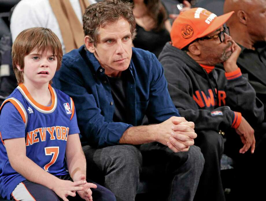 Actor Ben Stiller, center, sits between his son, left, and actor Spike Lee as they watch warmups before the Knicks faced the New Orleans Pelicans in New York on Sunday> Photo: Kathy Willens — The Associated Press   / AP