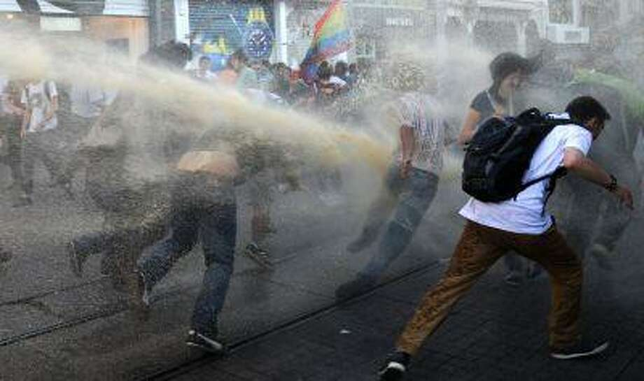 Turkish police disperse anti-government protestors with water cannons during a protest at the entrance of Taksim Square on July 20, 2013, in Istanbul. Photo: AFP/Getty Images / 2013 AFP