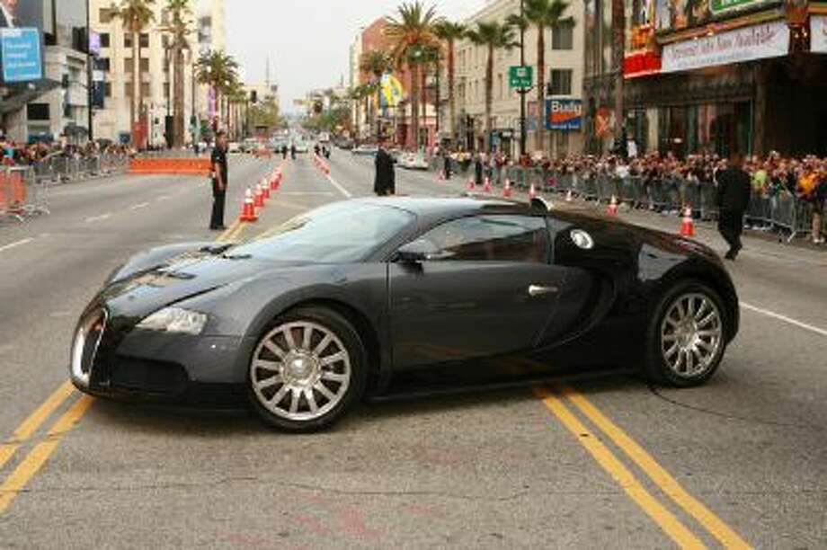 "Tom Cruise arrives in a Bugatti Veyron 16.4 during Los Angeles Fan Screening of Paramount Pictures' ""Mission: Impossible III"" at Grauman's Chinese Theatre in Hollywood, CA, United States. Photo: WireImage For Paramount Pictures / WireImage"