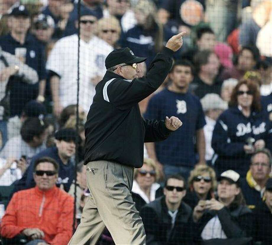 Umpire Dale Scott signals home run for Detroit Tigers' Miguel Cabrera after an instant replay review in the fifth inning of a baseball game against the Boston Red Sox Saturday, April 7, 2012, in Detroit. (AP Photo/Duane Burleson) Photo: ASSOCIATED PRESS / AP2012