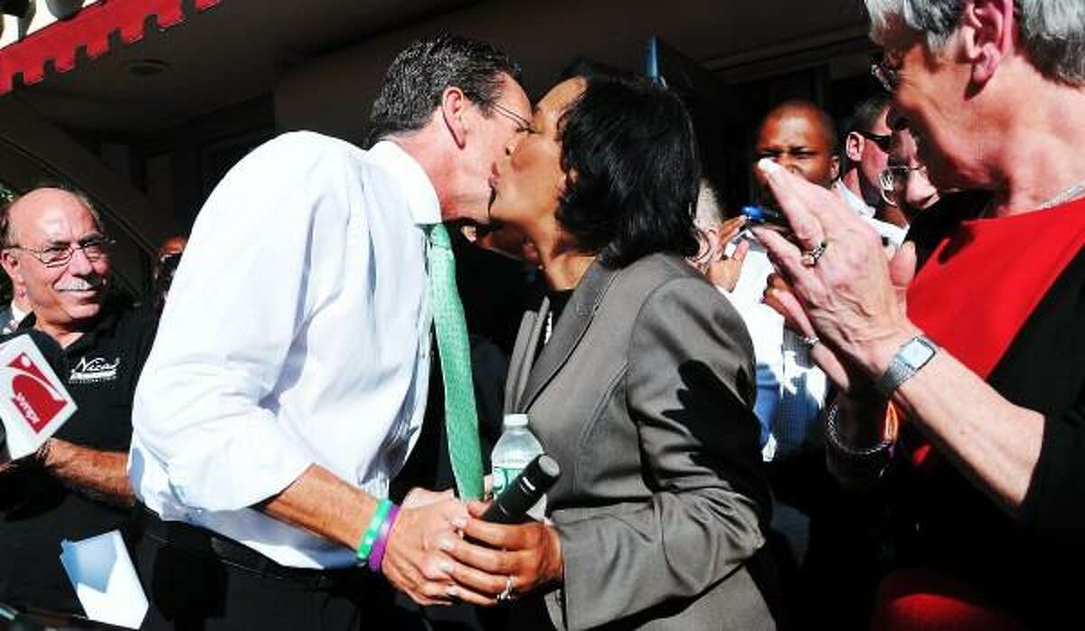 Senator Toni Harp smooches with Governor Dannel P. Malloy after Malloy endorsed Harp's mayoral bid for New Haven. Governor Malloy, Lt. Governor Nancy Wyman and Senator Martin Looney endorsed Harp during a rally at Nica's Market in New Haven. Peter Casolino - Register pcasolino@newhavenregister.com